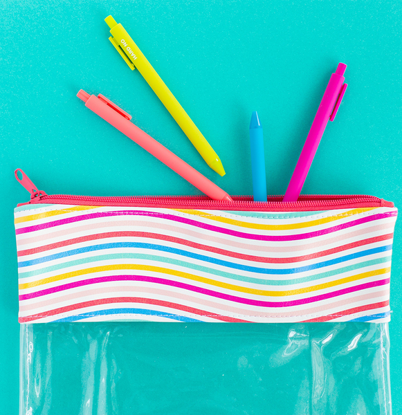 A pouch with clear vinyl and rainbow wavy line vegan leather.  There are bright colored jotter pens hanging out of the pouch.