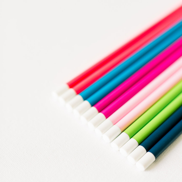Colorful pencil sets in rainbow colors.