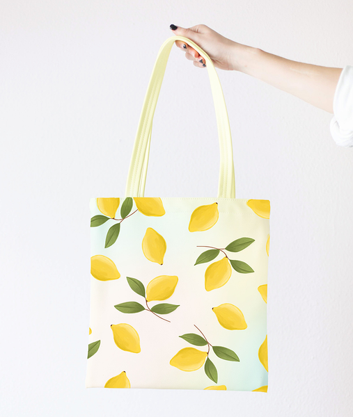 girl holding a cute tote bag with lemons