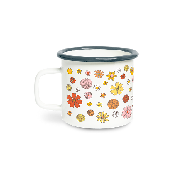 A white campfire mug with yellow, orange, coral, yellow, pink and white flowers spread all around the mug.