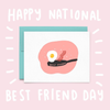 A white greeting card with a fried egg and a slice of back on a black skillet with the text