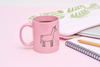 Funny coffee mug in pink with the outline of a simple cute unicorn printed on the front.