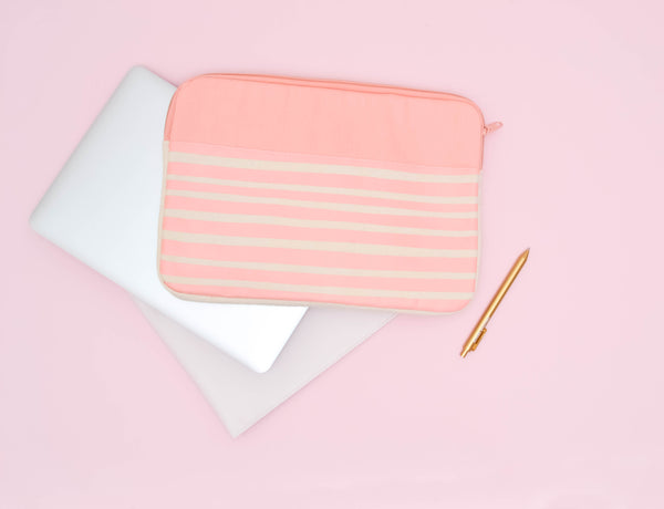 Peach Stripes Canvas Laptop Sleeve is a cute laptop sleeve in 13 inch size on top of a macbook
