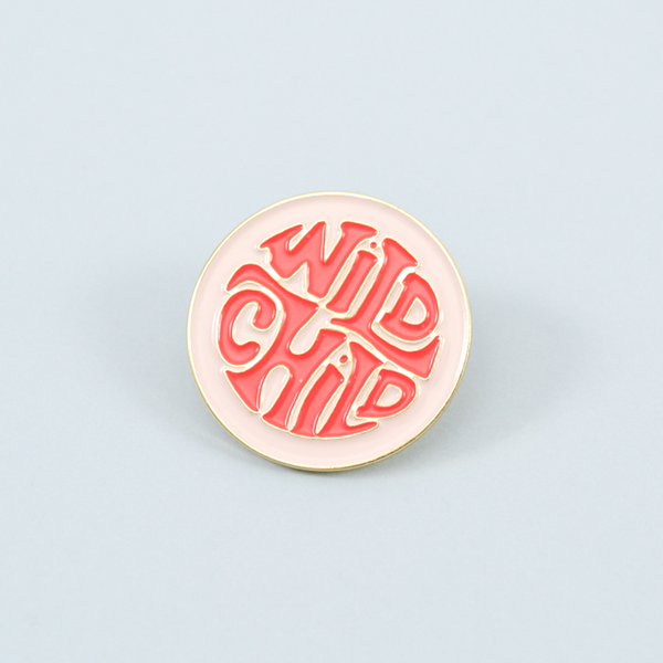 wild child enamel pin on a blue background