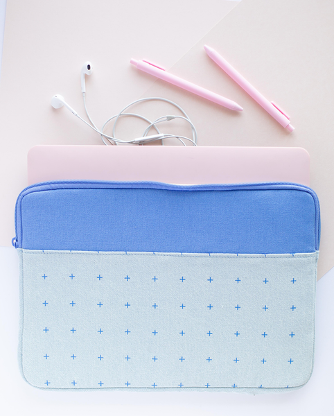 Plus 1 Canvas Laptop Sleeve is a cute laptop sleeve in light denim with blue plus pattern in 13 inch size with a laptop inside and three jotter pens outside