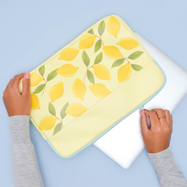 yellow laptop sleeve with lemons and blue zipper