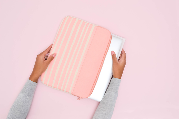 Peach Stripes Canvas Laptop Sleeve is a cute laptop sleeve in 15 inch size with a macbook inside