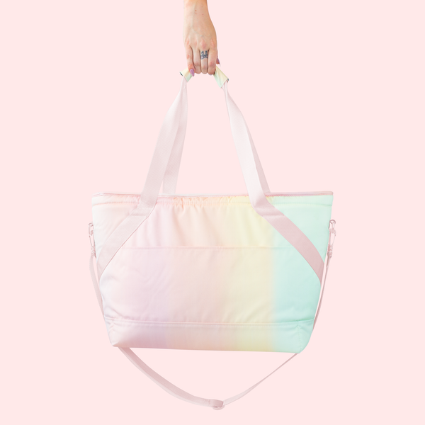 Girl holding pastel soft sided cooler bag