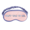 A sleep mask with periwinkle outline and strap that says don't talk to me