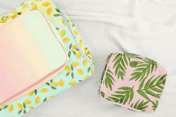small, medium, and large packing cube set. One with yellow lemons, one pastel gradient, and one with green leaves