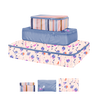 small, medium, and large packing cube set. One with magic sprigs print, one periwinkle, and one with purple and blue stripes