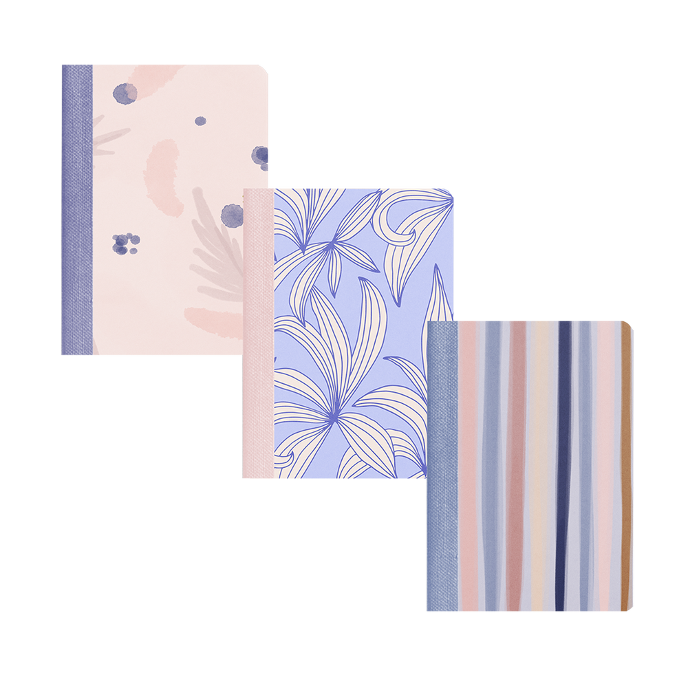 Three indigo dreams mini notebooks. One with periwinkle leaves, one with different color blue stripes, one with watercolor that is pink and blue