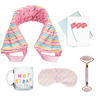 flat image of a collection of self care items including a neck wrap in a rainbow wavy line print, a clear glass mug that says not today, a weighted eye mask with a tiny hearts imprint, a greeting card that yes you can, and a rose quartz roller with roll with it imprinted in dark pink.