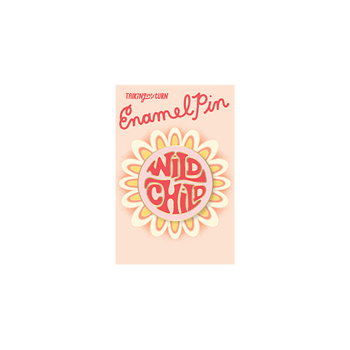 a cute circle enamel pin that says wild child