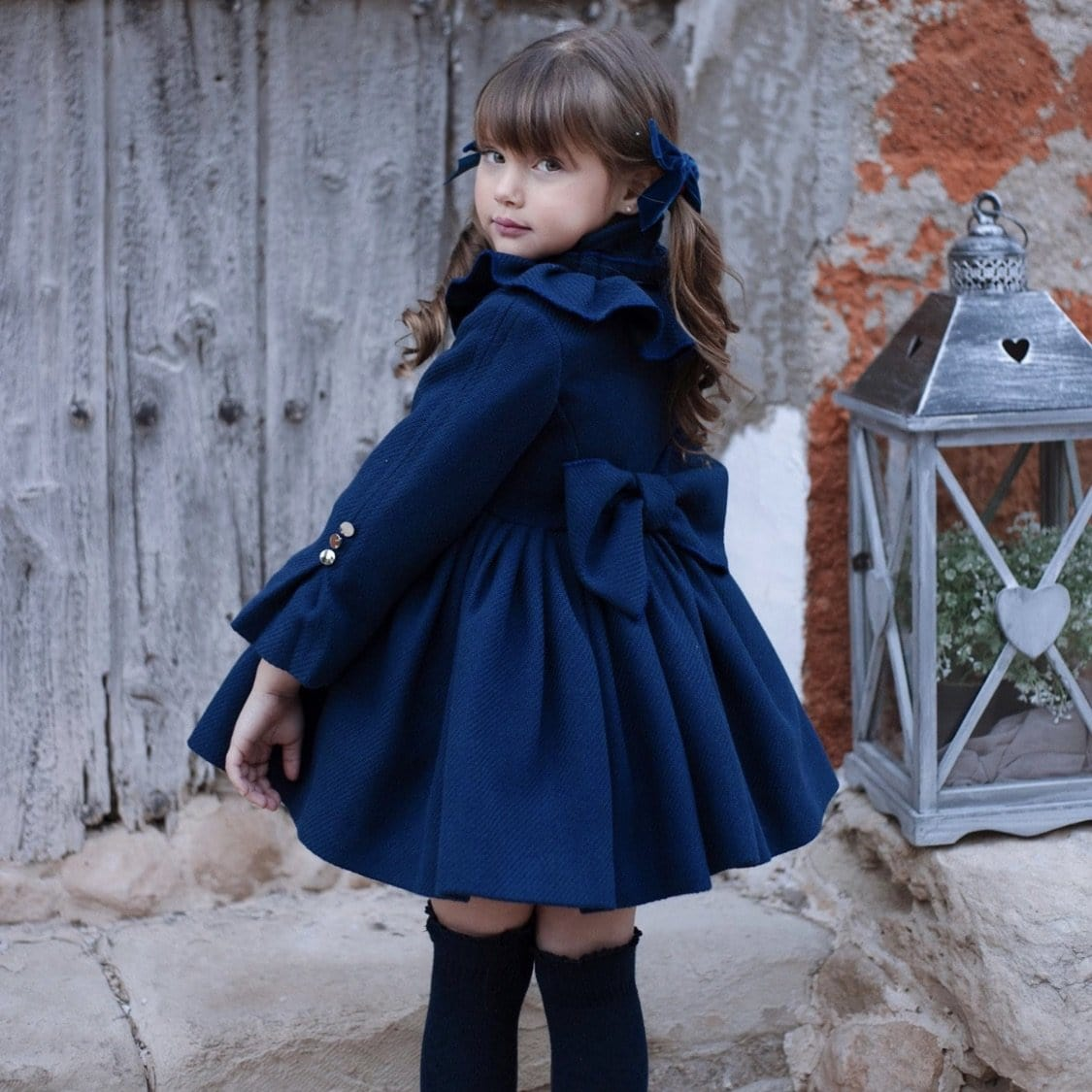 LA AMAPOLA NAVY PUFFBALL COAT