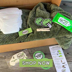Picture of a Deluxe Dutch Oven Kits Fart Blanket Gift Box - Tactical Green Color on a table