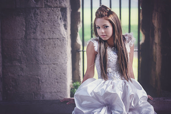 girl with long hair and white gown