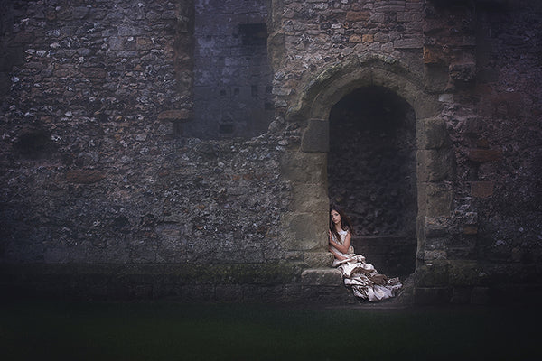 girl sitting in a castle