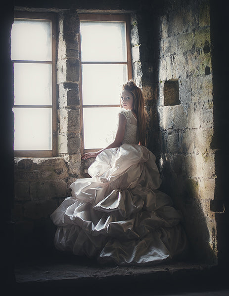 beautiful photography of a girl in a castle wearing a dress