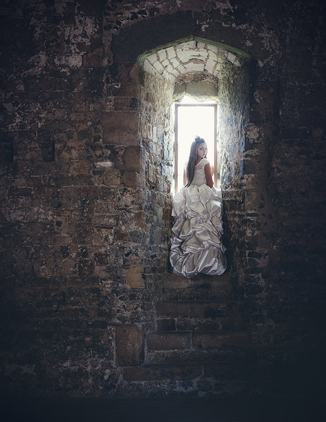 girl standing in a castle window