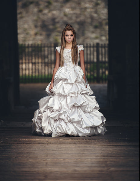 girl wearing white big ball gown in a castle