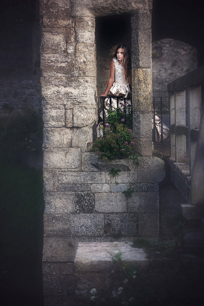 girl standing in a stone castle
