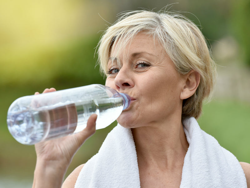 Lady drinking water for hydration