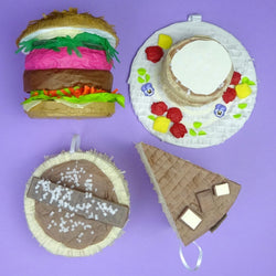 Food pinatas - burger, pancakes, slice of cake and empire biscuit, by Southside Pinatas