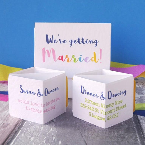 Rainbow wedding invite by Paperbuzz