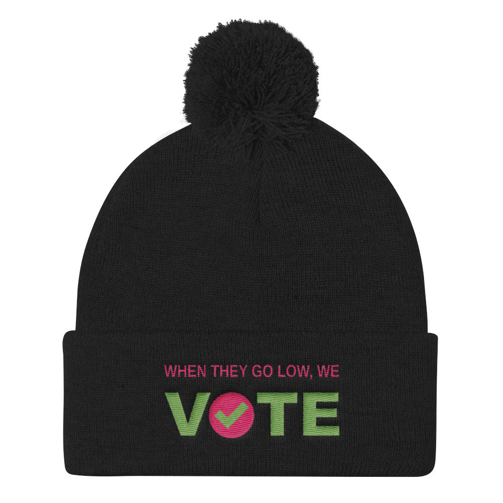 When They Go Low, We Vote™ Pom Pom Knit Cap