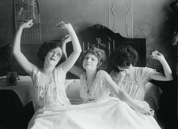 Photo of women wearing sleepwear pajamas in bed
