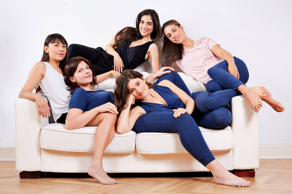 5 girls on a couch wearing hernest project sleepwear