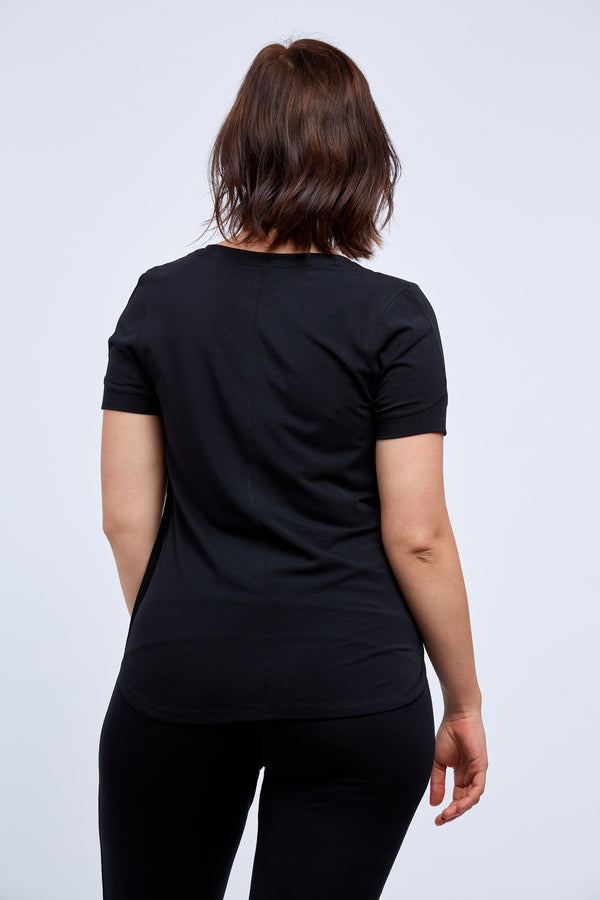 Woman wearing black womens comfortable tshirt for sleepwear, pajamas and loungewear back view