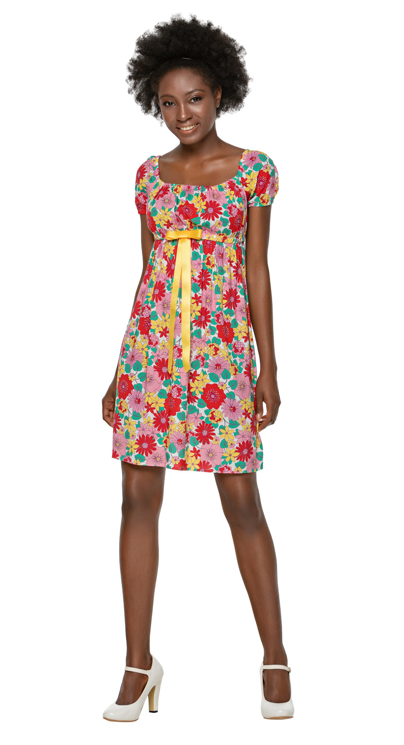 This light and airy peak summer 1960s style floral dress is made of a lovely breathable lightweight quality Spanish viscose. The gathered open neckline and gathered sleeves are complemented with a yellow ribbon which breaks up the floral pattern. As suited to a warm evening out as it is to a stylish casual covering over beachwear and as adaptable to flats as it is heels.