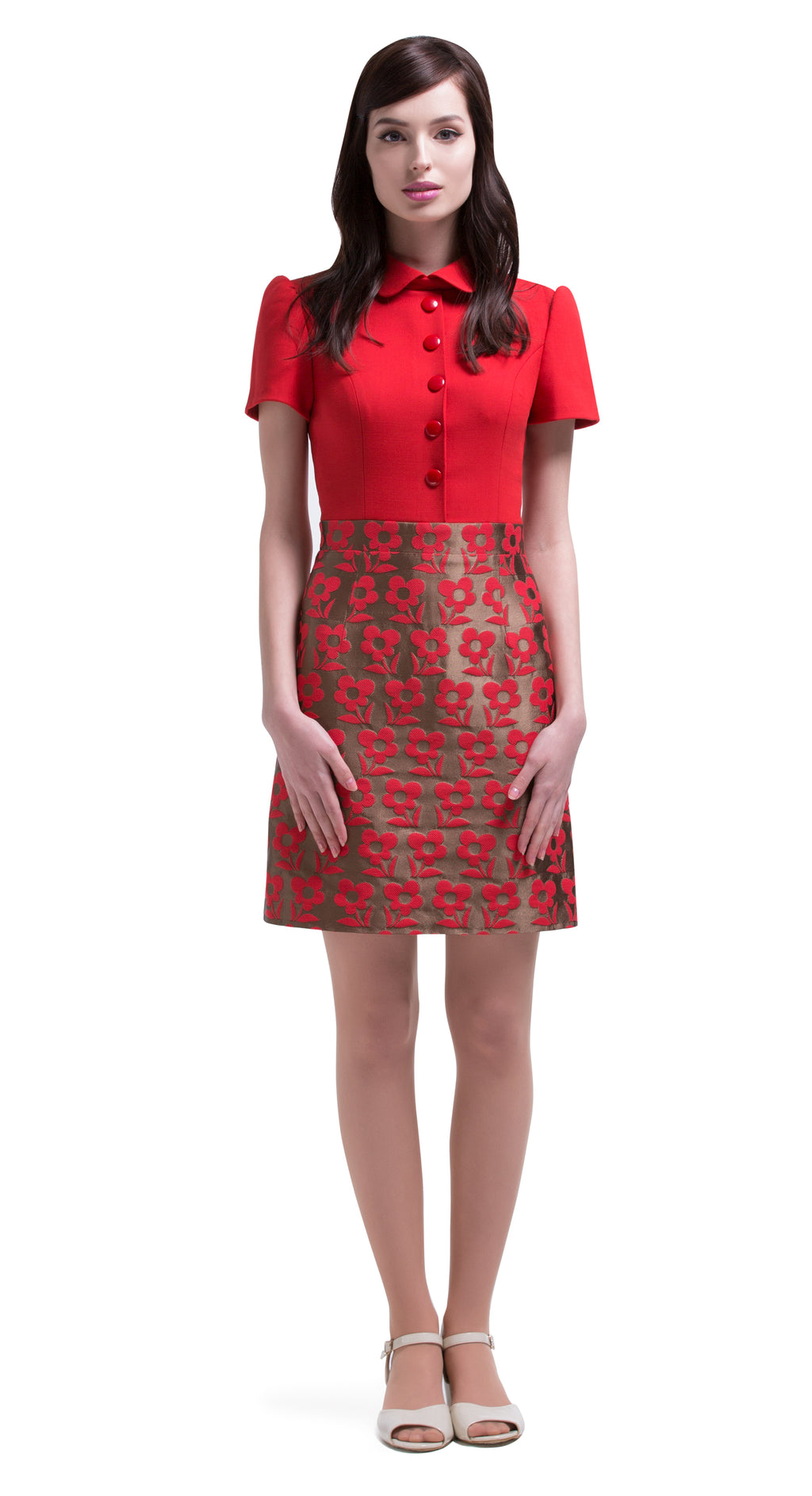 This cherry red and light copper, vintage style work or play style dress is immediately striking in its simplicity. A straight cut piece, with an elegant detailed bodice showcasing five button detailing, rounded collar and slightly puffed sleeves sits perfectly atop a stunning French mill floral embossed weave skirt.  Choose bespoke for alternative sleeve or skirt lengths.