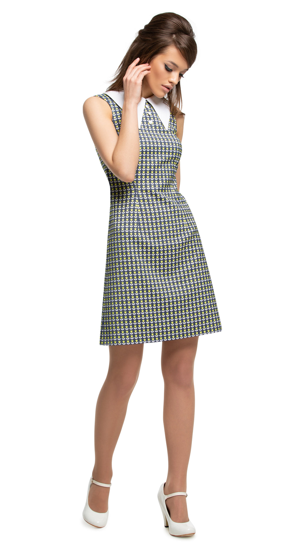 This mod, slightly a-line at-work or at-play Spring dress is made from a French weave tulip pattern, with a dramatic oversized pointed collar and three small button detailing. From office floor to dance floor, worn with casual flats or heels; it's a comfortable timeless style with an immediate flair by way of striking fabric and pin-sharp craftsmanship.  Choose bespoke to alternate to a peter pan collar or add capped, quarter or mid length sleeves.