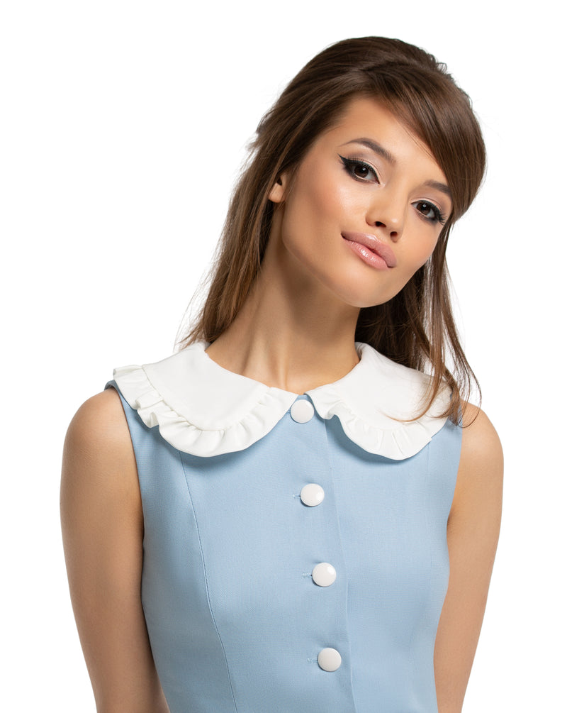 This charming fitted vintage inspired, Spring dress, made of a lovely high-quality Italian cotton, with a white ruffled collar, matching white belt and five button detailing provides an easy transition from work to play. Dusty blue, simple and elegant, dressed up or comfortably down, by way of shoes and accessories.  Choose bespoke to add capped sleeves or alternate colour scheme.