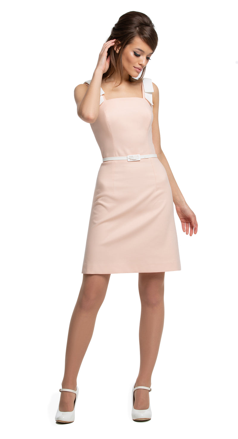 This fitted, Spring to Summer dress in a subtle dusty peach tone produced from Italian cotton, features detailed white bow straps and a patent leather belt. A fresh and easy piece is adaptable to both day and night, work or play.  Choose bespoke for a different colour combination.