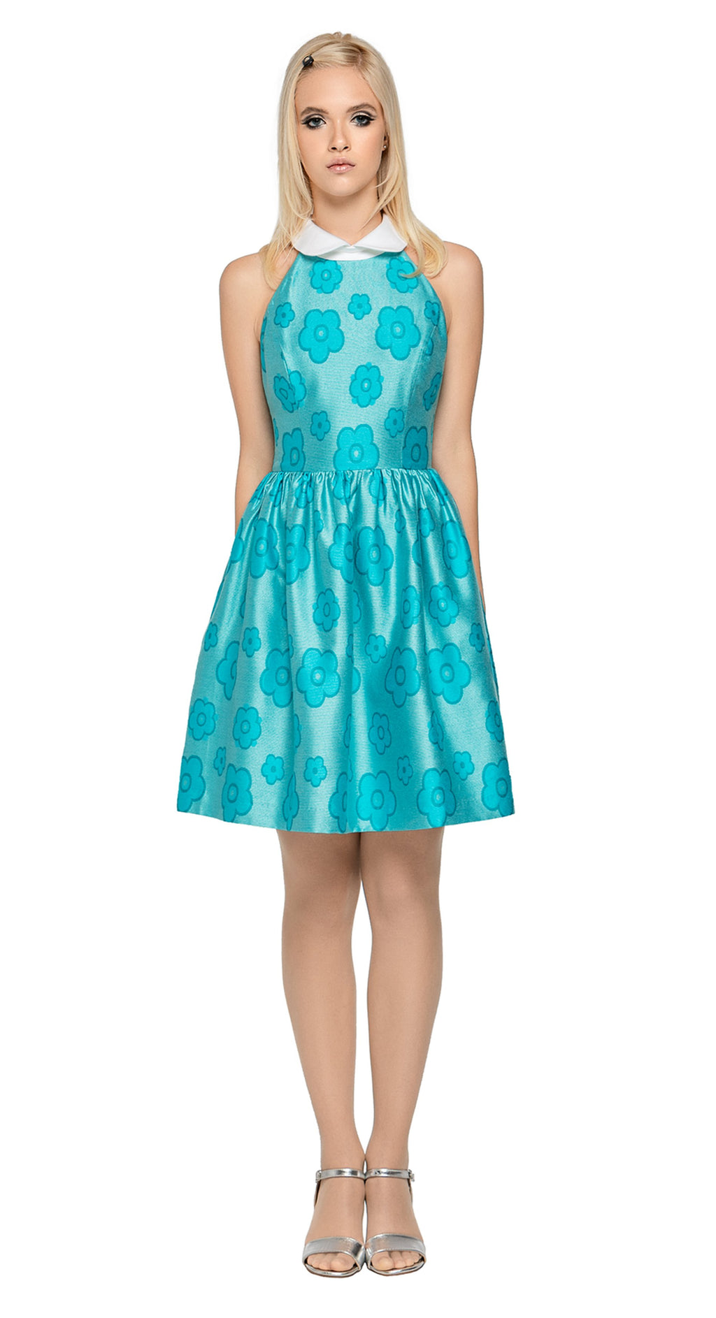 A retro style dress with gathered skirt and fitted bodice produced from an entrance making Spanish slightly sheen floral pattern for a big night out or event. Light and feminine and immediately retro feeling with a stand-up collar.    Choose bespoke if preferable to different coloured fabric (please inquire).