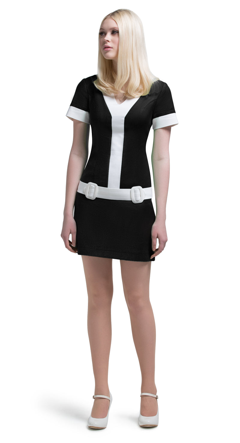 This straight cut, mod style, Italian cotton v-neck dress is light and comfortable. The contrast of white detailing within the v and within the decorative attached dual buckle belt is a refreshing take on the staple of a little black dress essential. A fun night out number; casual cute and confident, dressed up with heels, or relaxed with flats or vintage runners.