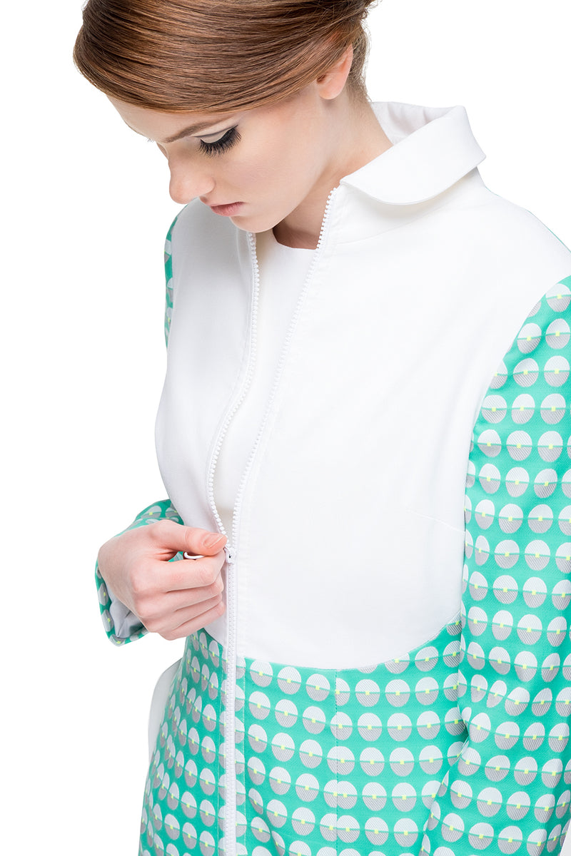 This a-line coat with a striking contrast between a beautiful French weave fabric and the pure white body perfectly displays  the form and cut of 60s style. Detailing by way of functioning side pockets and a looped vintage style front zip closes this fair weather coat off perfectly. Pairs with the matching dress of the same theme.