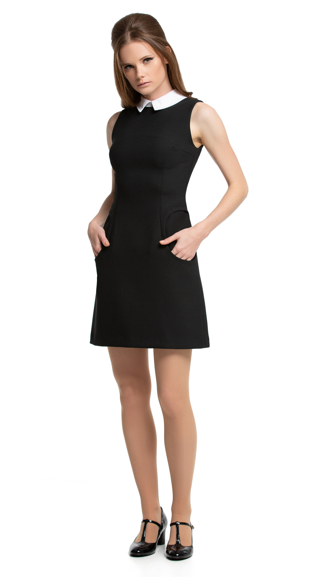 This little black fitted Spring dress has functioning mod circular pockets and a petite white collar which completes this simple, sharp and versatile piece for an easy to accessorize day to night look. Wear with the matching coat to complete the outfit.  Choose bespoke to add sleeves or for a different colour combination.