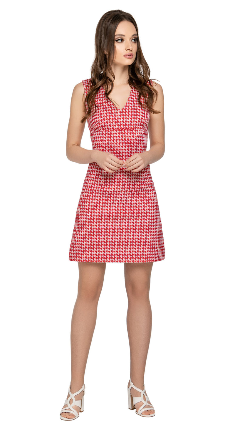 A medium-weight Italian houndstooth pattern, classic a-line fitted dress. A sleeveless piece with a v-neckline cut; an everyday at work or play style easily adaptable by accessorizing & choice of footwear. Back zipper, fabric provides some stretch.  Choose bespoke for rounded neckline or add sleeves if preferable to a covered arm.  Pairs perfectly with matching Houndstooth Coat to produce a perfect fair-weather high fashion set.