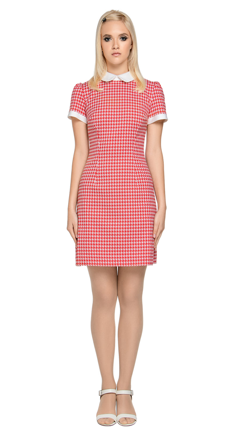 An Italian houndstooth classic fitted dress with detailed short, slightly puffed sleeves and stand up collar. An every day at work or play wardrobe go-to. Back zipper, fabric provides some stretch.  Choose bespoke for alternate sleeve length.    Pairs perfectly with matching Houndstooth Coat to produce a perfect fair-weather high fashion set.