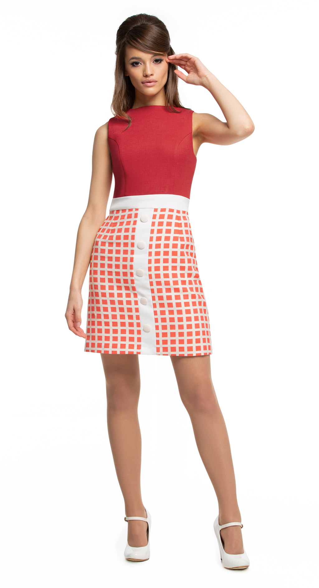 This fitted sleeveless Spring piece, is made of a muted red/light light cream or muted black/light cream, geometric pattern French weave. A fitted bodice and contrasting light cream waist to hem divide, detailed by a five button finish create a perfect at-work or at-play Spring look.  Pairs perfectly with the geometric pattern coat to complete a high fashion set.  Choose bespoke if preferring short sleeves.