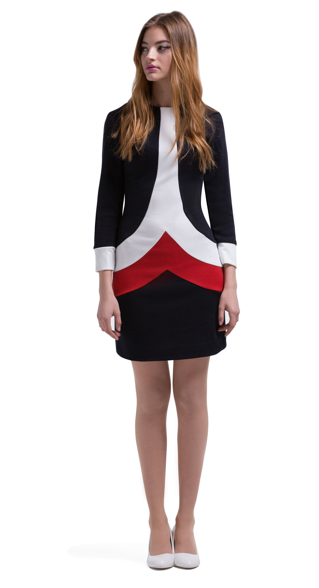 This Autumn, long sleeve Italian jersey straight cut dress delivers an immediate sixties retro impression through use of the chevron bodice panels creating a unique tric-olour stripe. Back zipper closure, full length sleeve with white cuff detailing. Generous stretch within the jersey; a comfortable dress without surrendering impacting style.