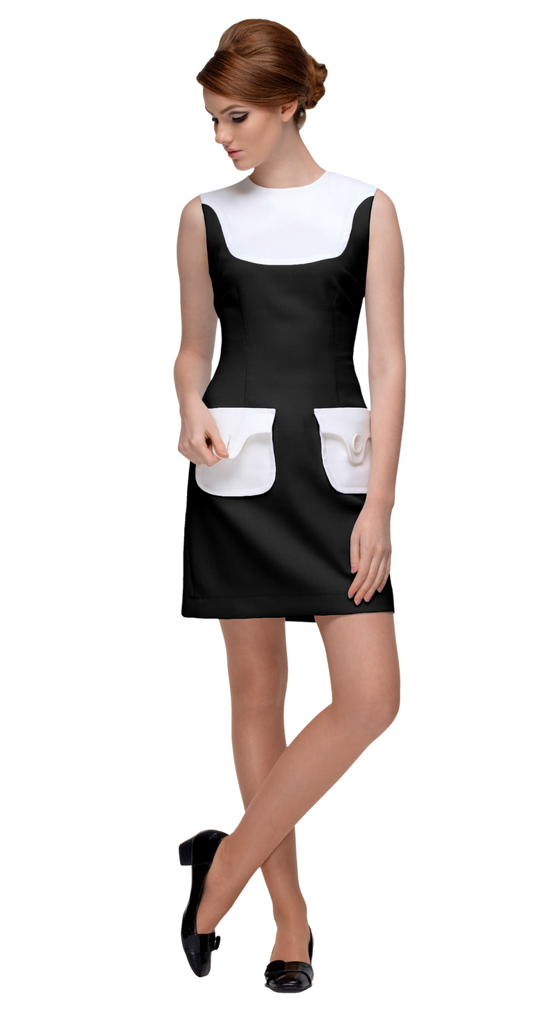 This fitted two tone sixties dress with functioning button pockets from quality cream and black Italian mill fabric lends itself beautifully to the simple and elegant shape of the cut. It's understated when worn within a professional setting and charming when worn for a social function. Paired with the matching coat of the same description, this set is an ideal consideration for formal events. When feeling good is to be easily achieved.