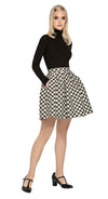 A fully lined French weave polka dot gathered skirt with back zipper closure. A versatile piece adaptable when worn with casual wardrobe staples from leotards to t-shirts (universal black polo neck shown; sold separately).  This skirt pairs perfectly with our Polka Dot Coat to create an impacting fun and stylish high fashion skirt and coat set.