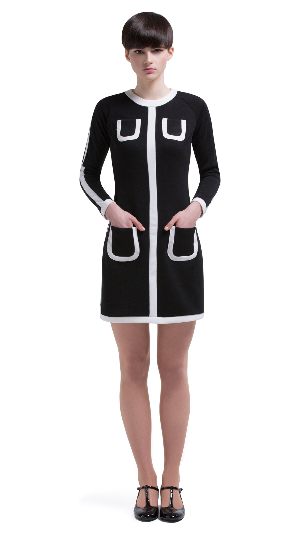 This straight cut, undeniably cool retro dress is made of an Italian jersey. A light cream rounded neckline leads into a bodice stripe dividing four perfectly placed functioning pockets. Full length sleeve with a complimenting light cream stripe and cream band cuff.  Generous stretch within the medium weight jersey. This versatile and flattering style can be dressed up by accessorizing or toned down with comfy kicks for both at-work and play.