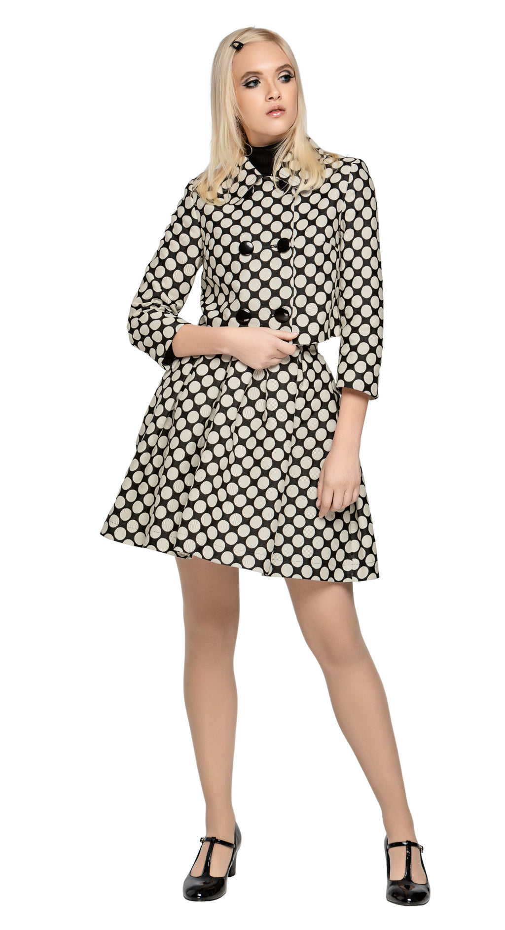 Retro style, fitted French weave polka dot fair weather cropped jacket with detachable bow. A striking fabric in both quality and appearance compliment the timeless fit.  This jacket is fully lined with eight button front panel closure.  Pairs perfectly with our Polka Dot Skirt or our Circle Cutout Dress to create an impacting fun and stylish high fashion skirt/dress and coat set